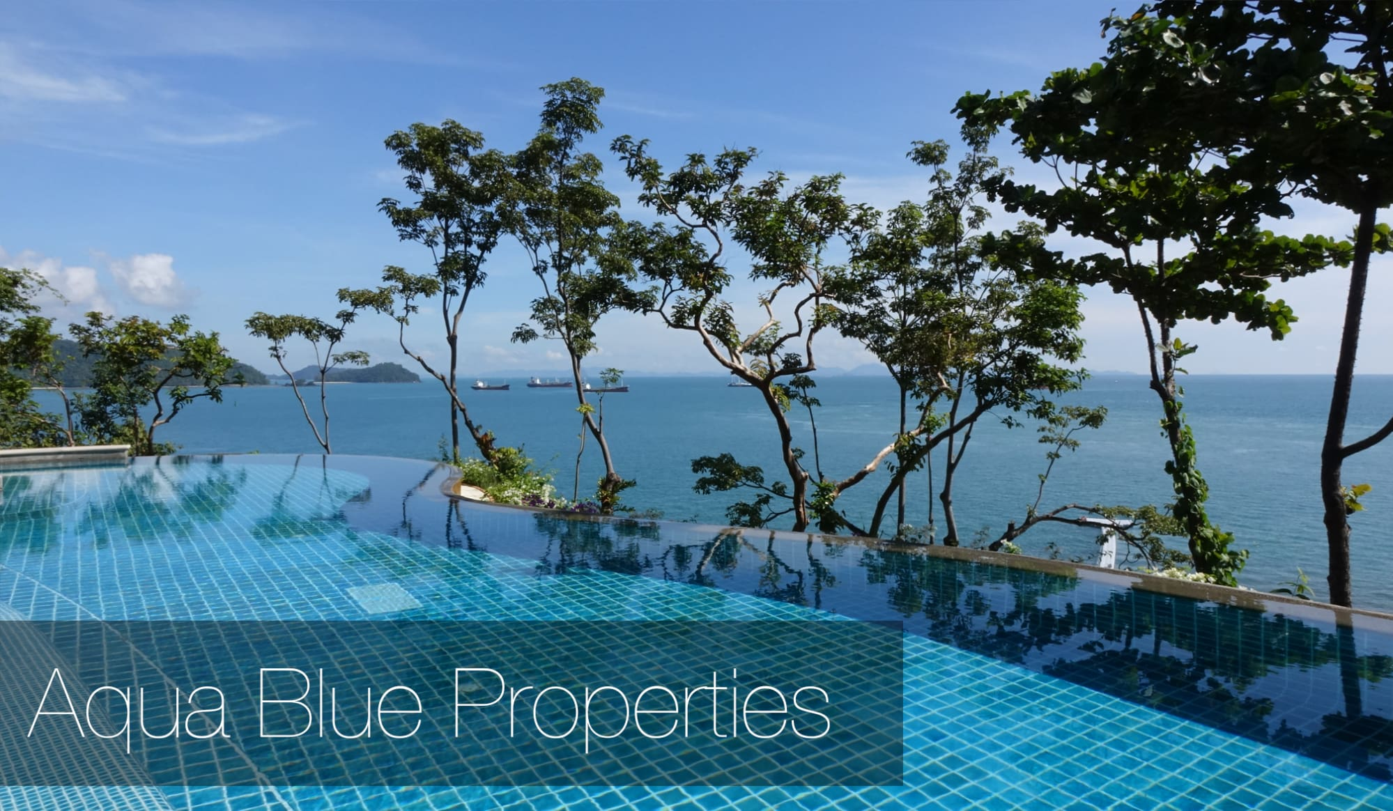 Photo of beautiful resort, with infinity pool, overlooking blue bay