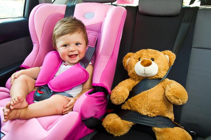 bigstock-Baby-Girl-Smile-In-Car-38034541-1.jpg
