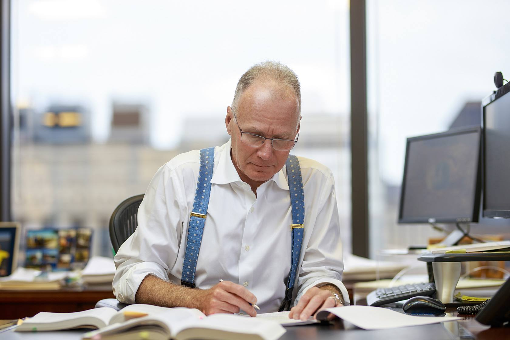 Peter King reviewing documents