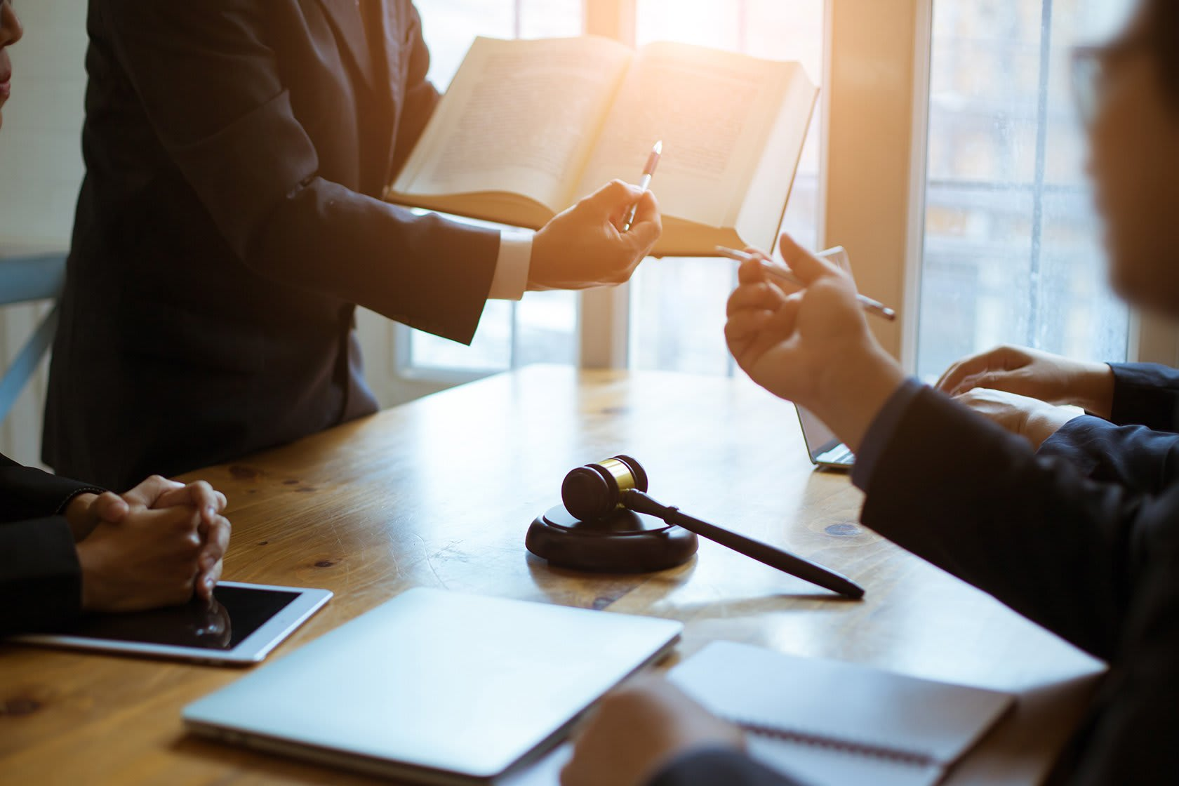 Legal meeting with man pointing to book