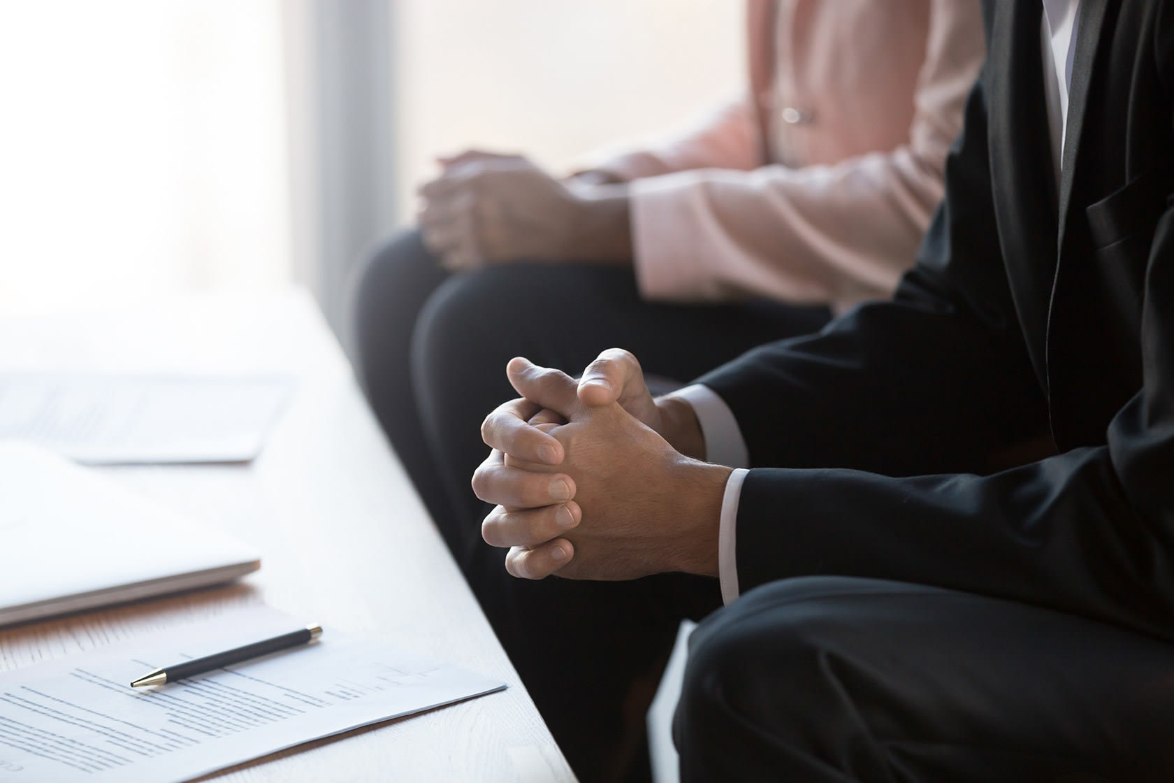 Two people at desk in a meeting