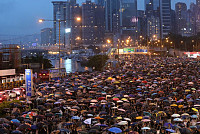 Hong Kong protesters gather as nearly...