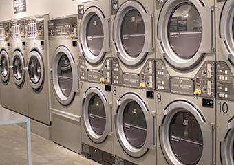 従業員がセルフランドリーで洗濯している手間を軽減したい。