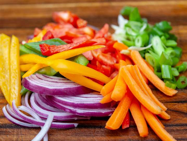 thinly sliced vegetables on a cutting board