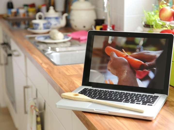 person peeling a carrot during an online cooking class   Classpop