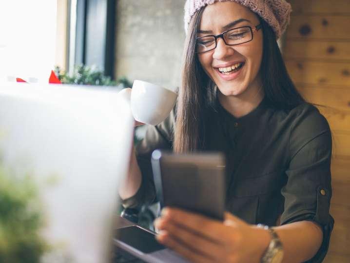 woman playing virtual bingo on her phone