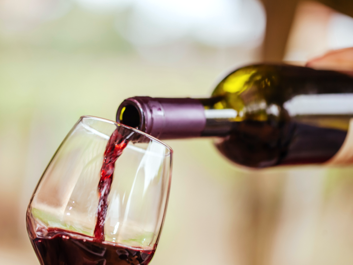 person pouring red wine into glass   Classpop