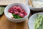sushi mise en place with tuna, cucumber, scallions and rice