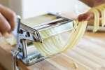 chef cutting fresh pasta