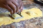 St. Louis - chef hands stamping out filled ravioli.jpg