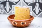 block of parmesan cheese in a bowl