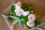 shrimp and vegetables on rice paper to make spring rolls