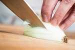 chef slicing an onion