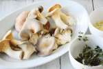 mushrooms and herbs in while bowls