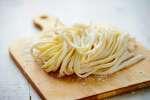 fresh pasta on a cutting board