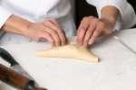 empanadas on a baking sheet