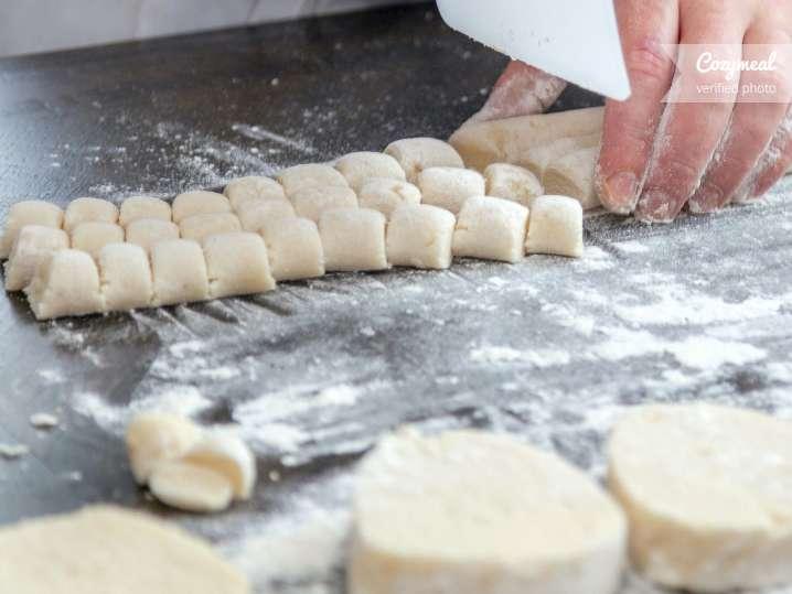 chef cutting gnocchi