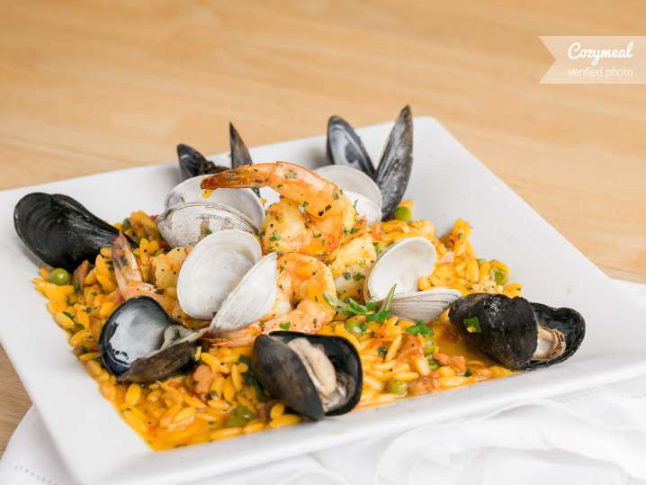 seafood paella with mussels clams and shrimp
