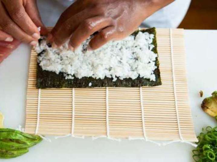 laying sushi rice on nori