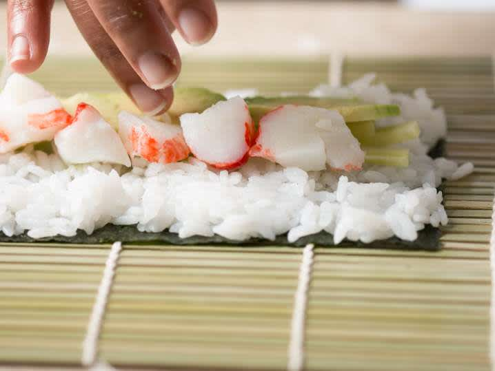 making homemade california roll sushi