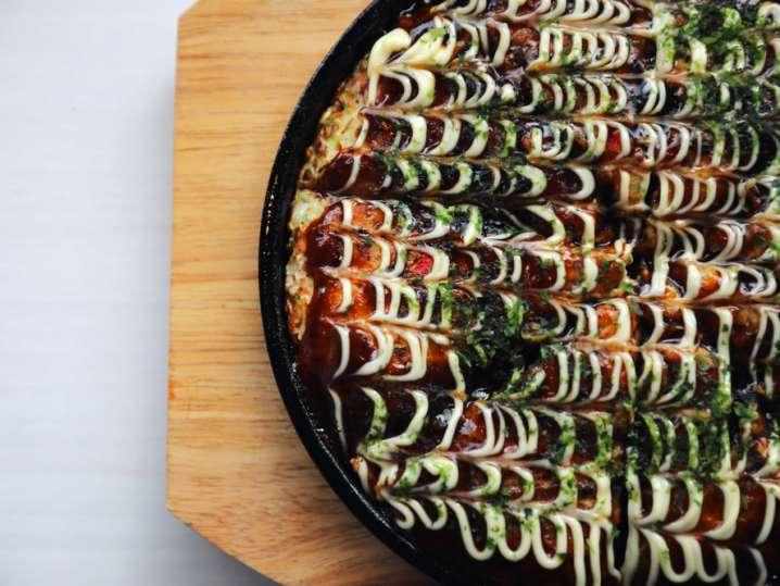 Overhead shot of okonomiyaki served on a plate