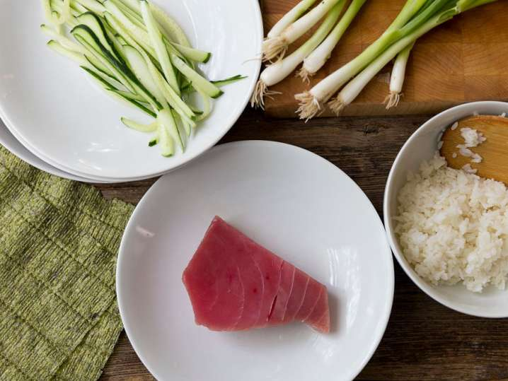 tuna, cucumber, scallions, and rice for making a spicy tuna roll