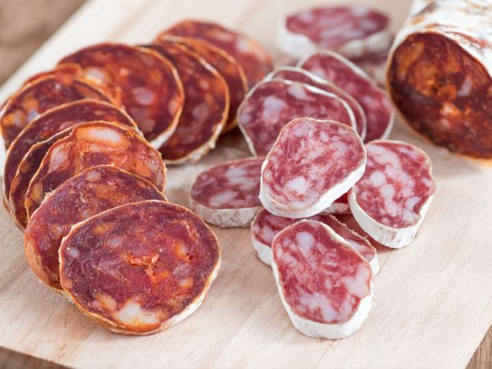 sliced chorizo on a cutting board
