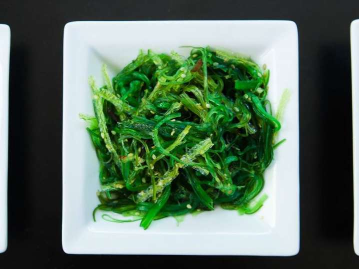 seaweed salad in a white bowl