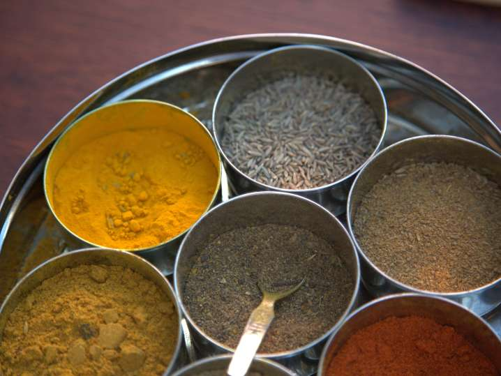 bowls of indian spices on a tray