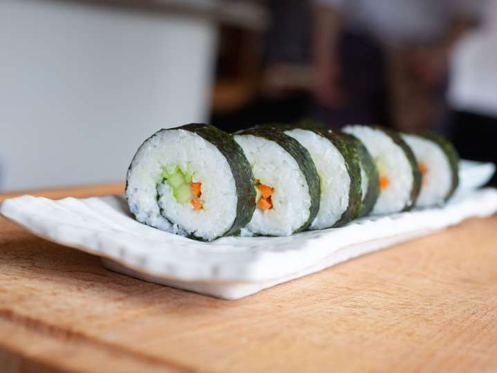 sushi rolls with rice carrots and cucumbers