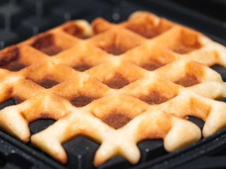 waffle cooking in a waffle iron