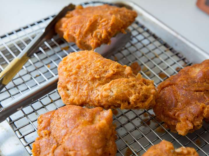 fried chicken on a drying rack