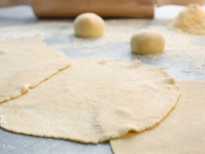 homemade tortillas on a floured work surface