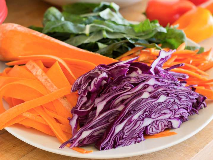 sliced vegetables on a plate for spring roll filling