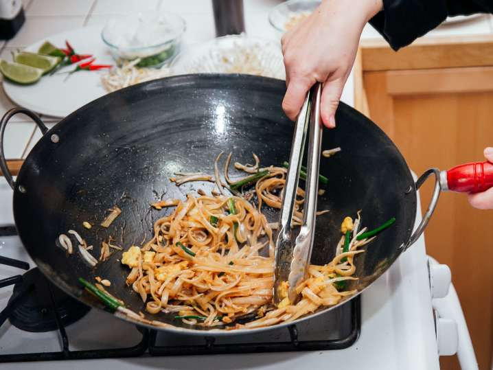 Denver - stirring pad thai in a pan.jpg