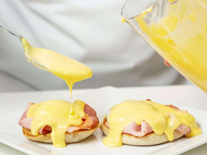 Los Angeles - drizzling homemade hollandaise onto parma ham and english muffins.jpg