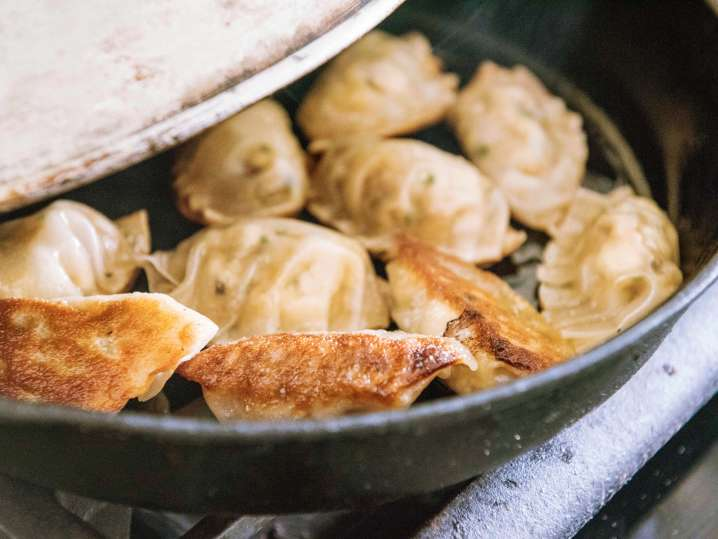 potstickers frying in a skillet