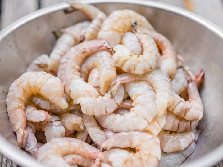 raw shrimp in a mixing bowl