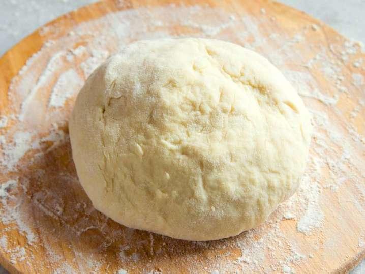 homemade gnocchi dough on a floured work surface