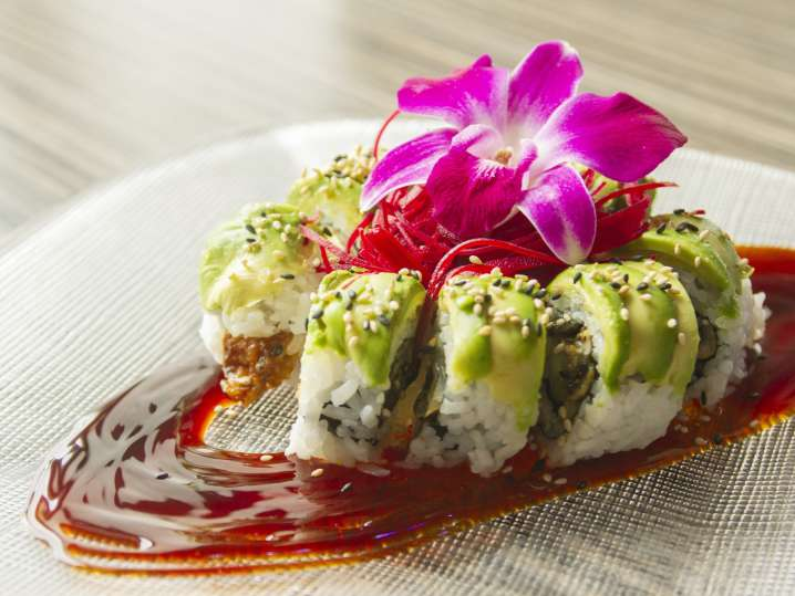 plated vegetable caterpillar roll on a plate