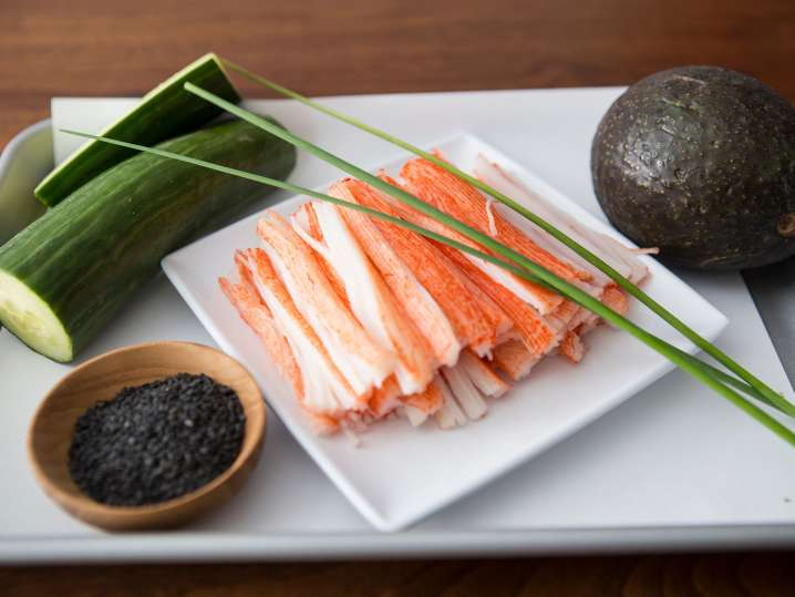 chef's knife, fresh tuna, and scallions on a cutting board
