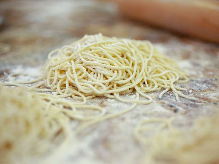 homemade ramen noodles on a floured work surface