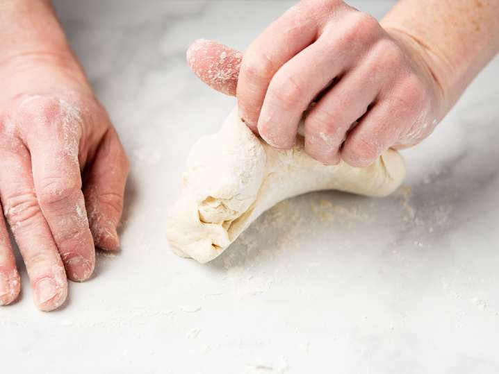 chef kneading fresh pasta dough