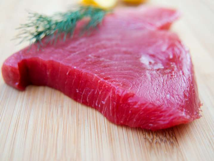 fresh tuna steak on a cutting board