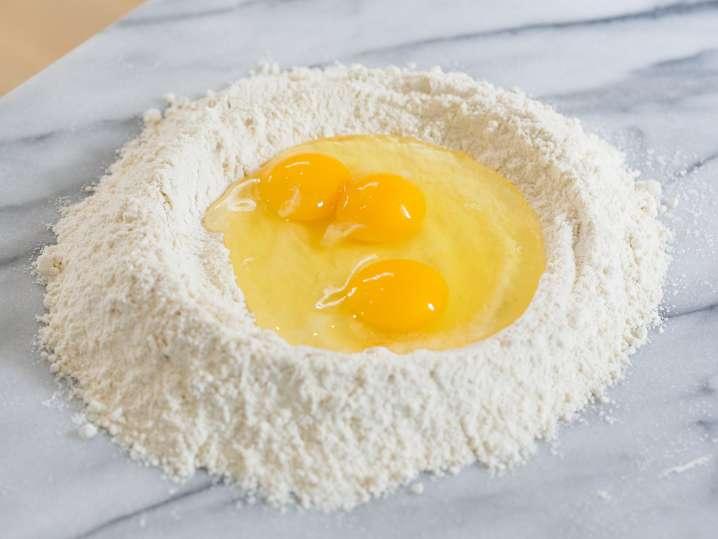 eggs and flour to make homemade pasta dough