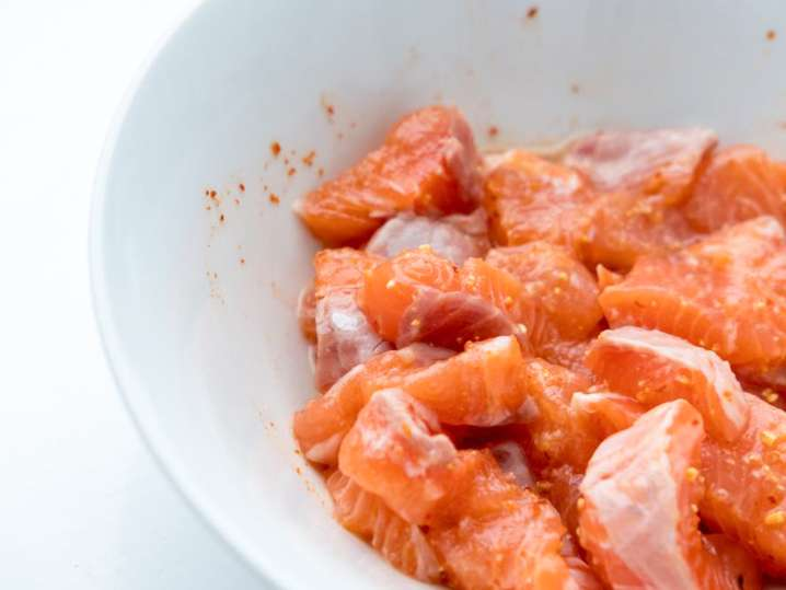 salmon in a white bowl