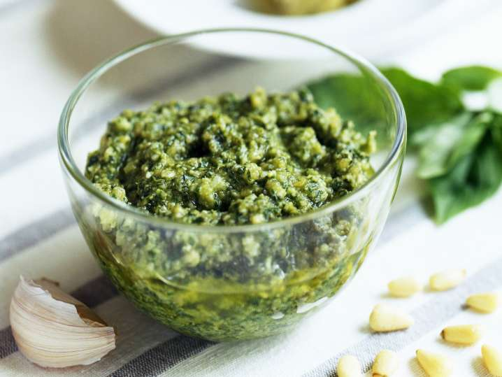 pesto in a bowl with basil, garlic and pine nuts