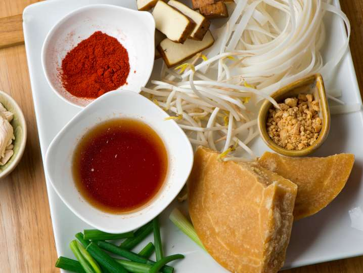 ingredients for making pad thai on a serving dish