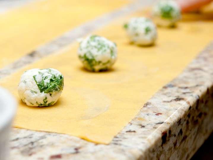 cheese ravioli filling on pasta sheet
