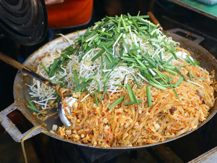 Phoenix - chef cooking pad thai in large skillet.jpg